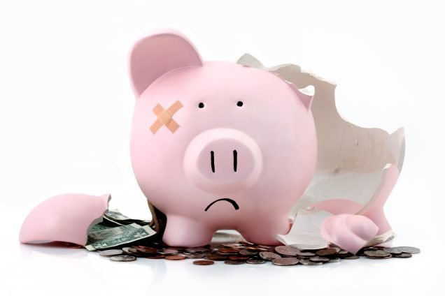 Broken piggy bank to represent bad economy or investments