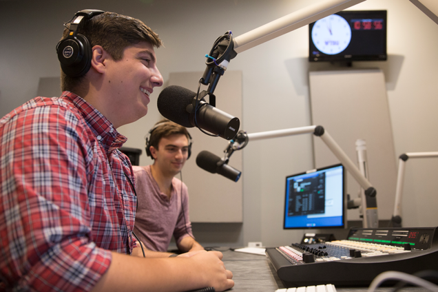 2017 Executive Board Members Kyle Davi (GM) and Adrian Thomas (BU in the Morning Director) broadcast live for the first time out of the new WTBU studio. (Photo Credit: BU Today)
