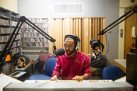2015 WTBU General Manager DJ Rock sits in the old WTBU studio (Photo Credit: BU Today)
