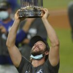 Clayton Kershaw lifting the World Series Trophy.